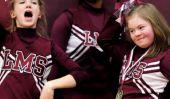Les joueurs de basket-ball de collège défendent une pom-pom girl intimidation dans la manière la plus parfaite